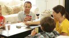 Boy Wins Family Card Game Stock Footage
