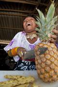 Laughing and cutting a pineapple kuna yala panama Stock Photos