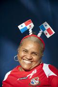 happy woman with the panama flag city central america - stock photo