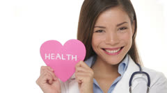 Medical Health Care - Doctor showing heart sign - stock footage