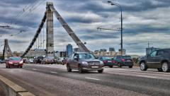 Many cars ride over Crimean Bridge in Moscow Stock Footage