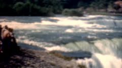 Stock Video Footage of 1950s people viewing Niagara Falls following water big waterfall vintage