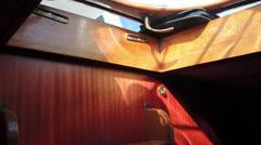 Shadow play on mahogani wood interior Stock Footage