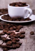 White cup of espresso full of coffee beans Stock Photos