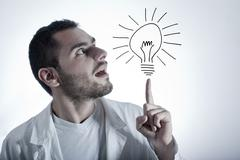 young researcher with an idea - stock photo