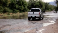 Stock Video Footage of Location 3 - Deep Flash Flooding Rural Street truck pushes water