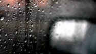 Stock Video Footage of Rear view mirror through rained on window that start to fog up