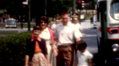 8mm 1960s famliy walking on sidewalk from city bus vintage fashion Stock Footage