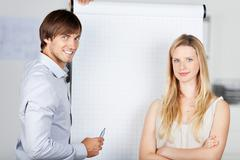 Stock Photo of business people with flipchart