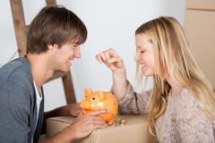 couple saving money - stock photo