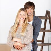 Stock Photo of happy young couple renovating their home