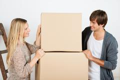 couple looking at transport boxes - stock photo