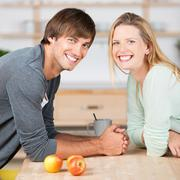 Stock Photo of happy couple in the kitchen