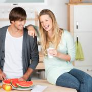 young couple having fun in the kitchen - stock photo