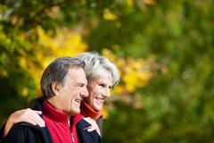 laughing affectionate senior couple - stock photo