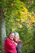 A happy senior couple posing at a forest Stock Photos