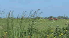 Red tractor at work Stock Footage