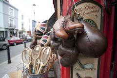 old leather items for sale portobello market london - stock photo