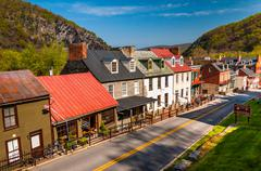 view of historic buildings and shops on high street in harper's ferry, west v - stock photo