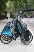 public bicycles in row london city ingland - stock photo