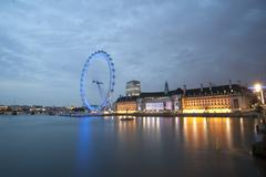 illuminated urban scene by the river london city ingland - stock photo
