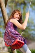 Happy girl on the swing Stock Photos