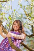 Happy young climbing tree Stock Photos