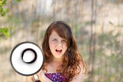girl shouting loud with megaphone - stock photo