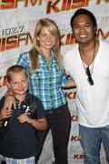Candace cameron, her son lev valerievich bure and kiss fm 'manny guevara.kiss Stock Photos