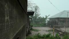 Hard Rain in a small Jungle Village Stock Footage