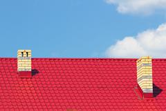 Red roof with chimneys Stock Photos