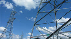 Tall electric masts against cloudy sky - timelapse 4k Stock Footage