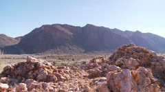 Dolley shot showing arid and rocky Namibian border Stock Footage