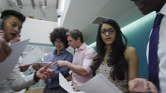 Young casual business team working together in a contemporary office Stock Footage