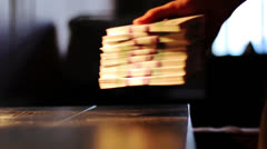 Man puts a packets of money on the table Stock Footage