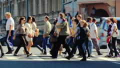 Pedestrians crossing the roadway Stock Footage