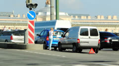 Driver calling near accident vehicles - stock footage