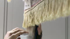 combing rug fringe - stock footage