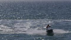 Riding on personal water craft Stock Footage