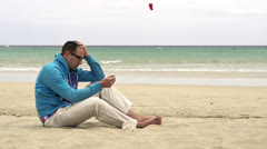 Young man sitting on the beach, slow motion shot at 240fps Stock Footage