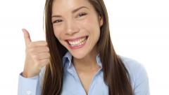 Happy casual business woman giving thumbs up - stock footage