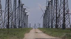 Road through wind turbine farm Stock Footage