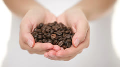 Coffee beans - woman showing coffee bean handful Stock Footage
