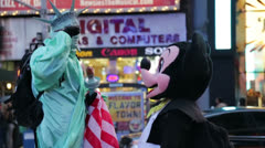 Statue of Liberty and Mickey Mouse in Times Square, New York Stock Footage