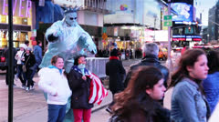 Tourists Taking Pictures with Famous Characters in Times Square, New York Stock Footage