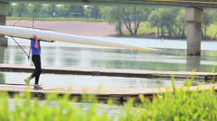 Rower finishing training on Jarun lake - stock footage