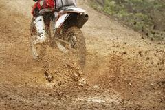 Motocross bike increase speed in track Stock Photos