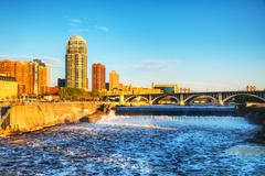 downtown minneapolis, minnesota at night time and saint anthony falls - stock photo