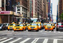 yellow taxis at the new york city street - stock photo