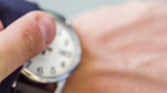 Checking Watch on Wrist for Time at 9 o'clock Morning Wristwatch Closeup Close - stock footage
